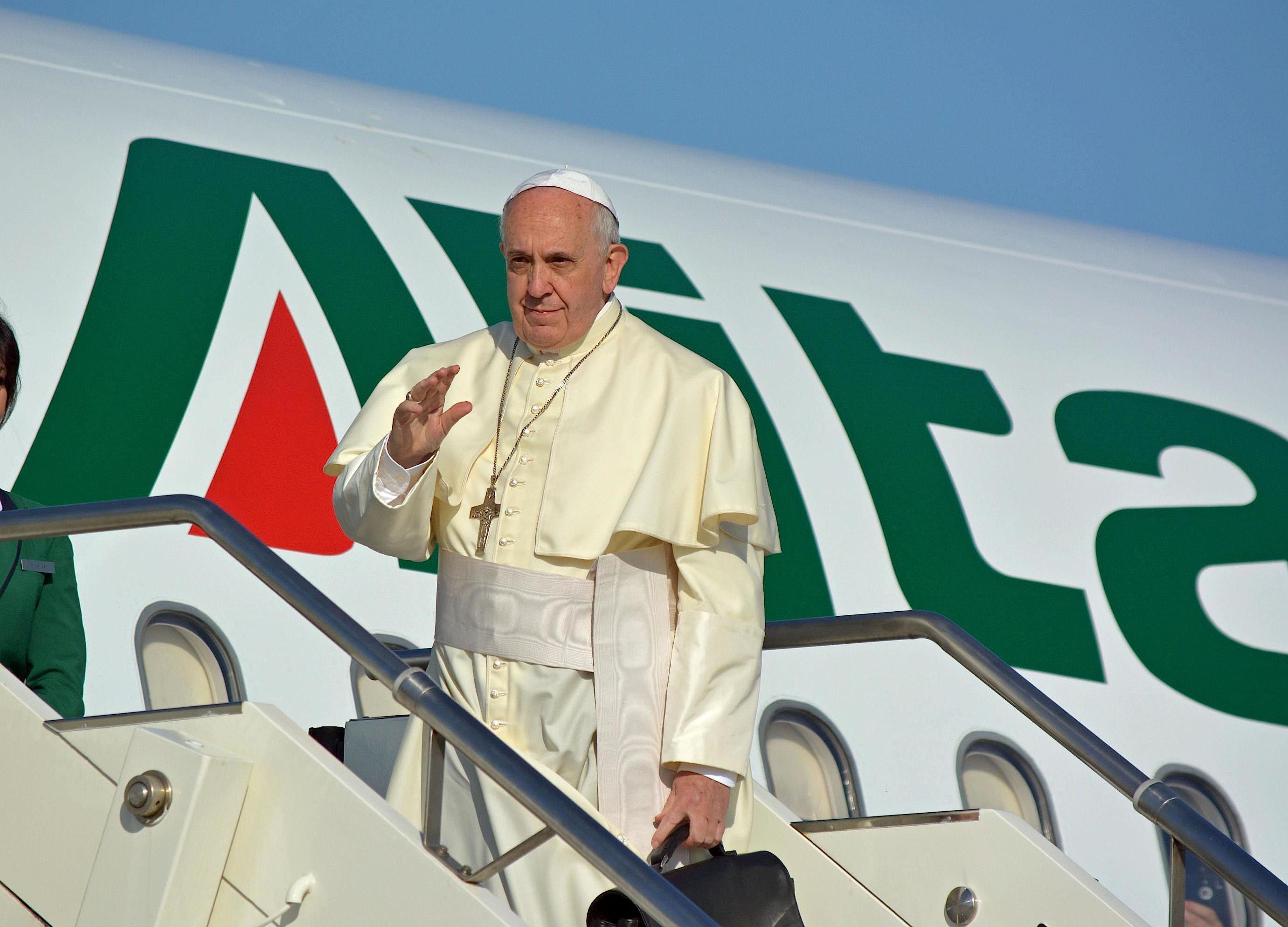 Pope Francesco greets before boarding Alitalia Airbus A321 for Amman at 'Leonardo da Vinci' international airport in Fiumicino