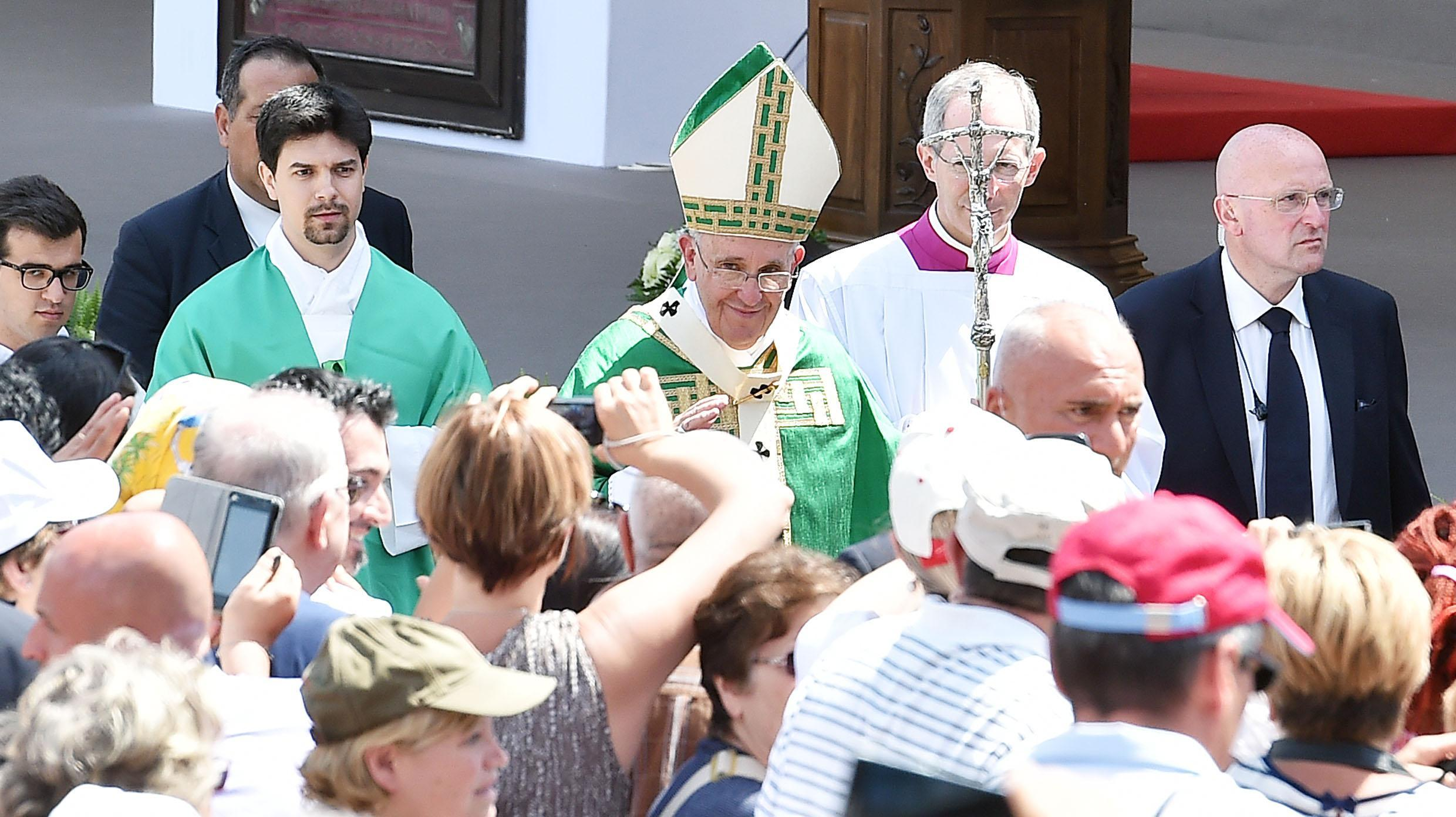 Pope Francis greets faithful as he leaves Piazza Vittorio in Turin after the celebration of Holy Mass on Sunday