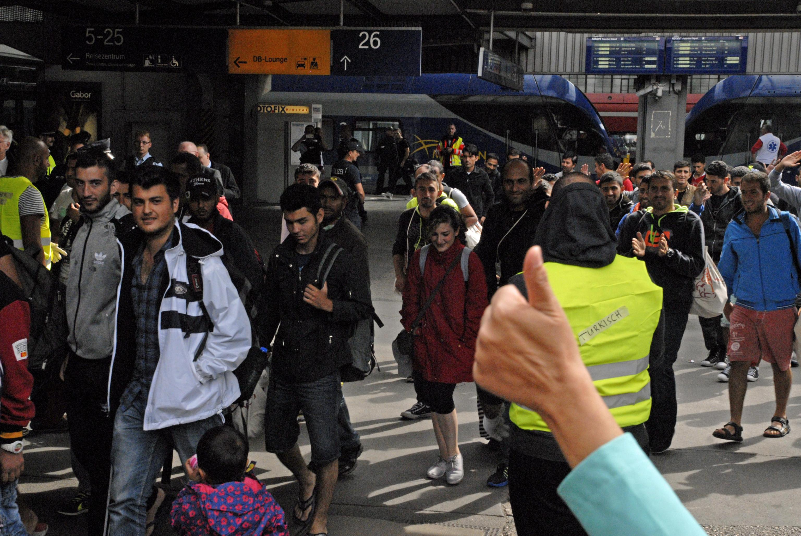 Train carrying about 500 mostly Syrian refugees arrived from Austria in Munich